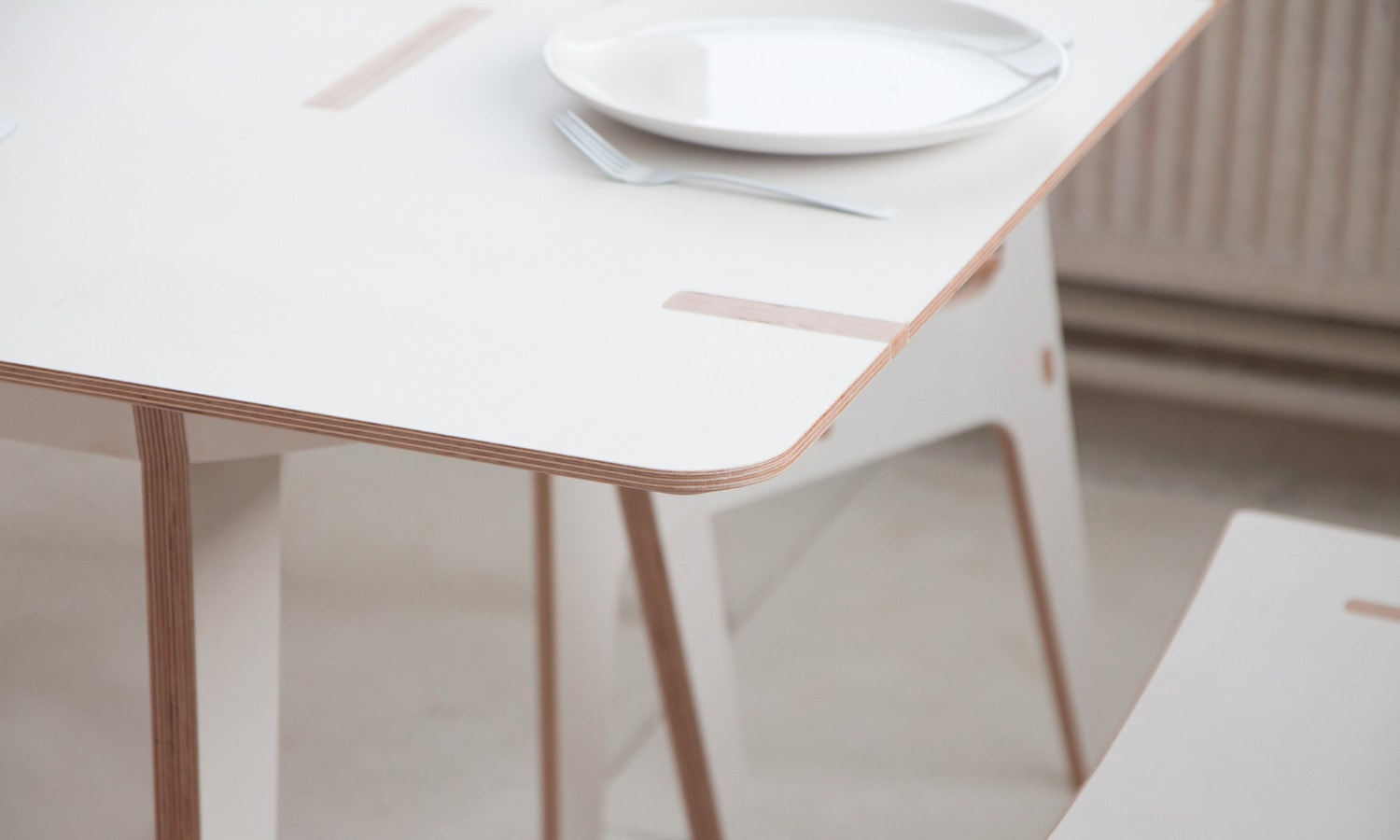 The dining room collection is inspired by the aesthetics of Viking boats, which influenced the shape of the furniture as well as the name. I designed the dining room furniture with visible joints, which create aesthetic details making the furniture unique. The parts from which the furniture is assembled are CNC cut with 5 axis from birch multiplex boards. Design by Jiri Krejcirik.