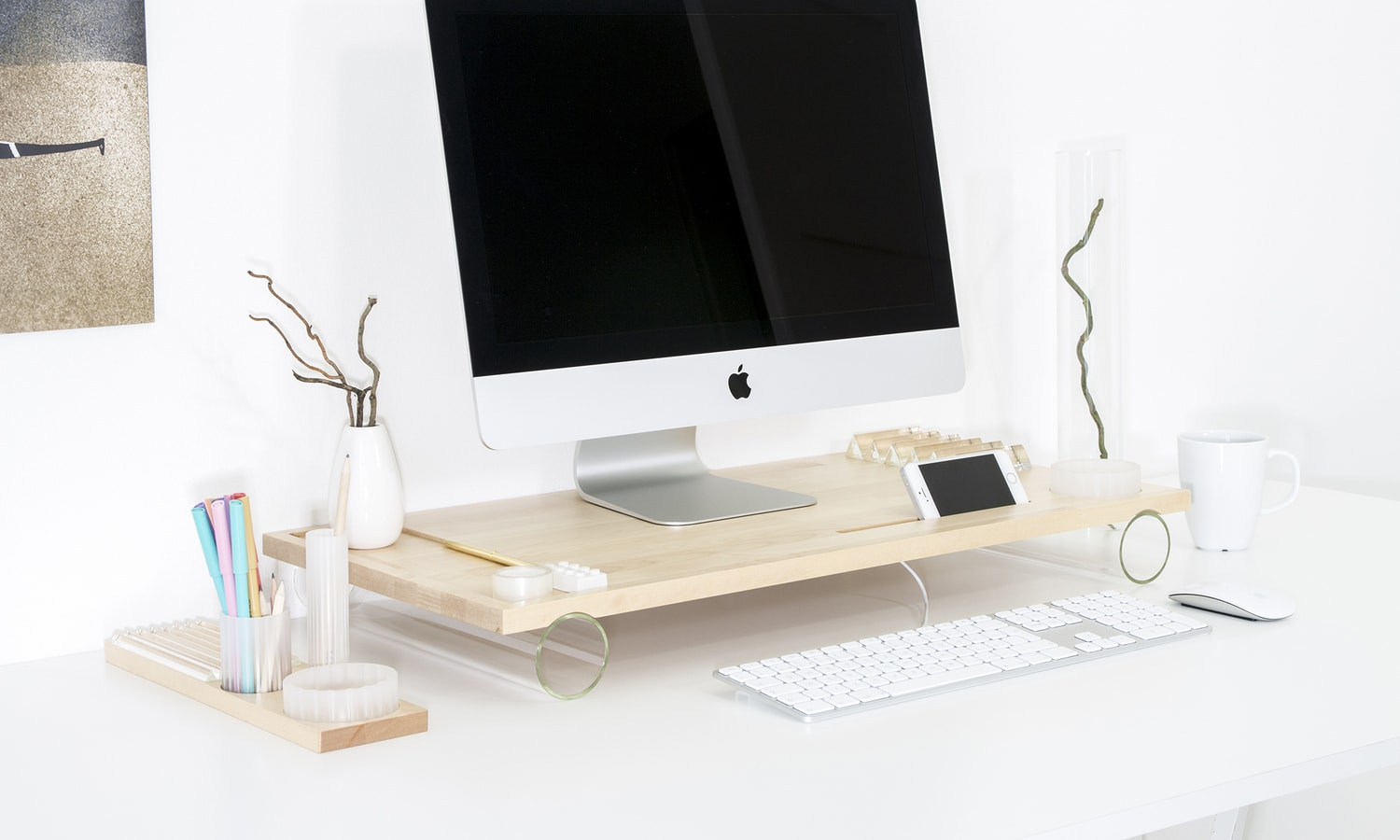 A modular stand for stationery inspired by industrial aesthetics. It is made of solid wood in combination with prefabricated parts from technical glass Simax. Designed by Jiri Krejcirik.